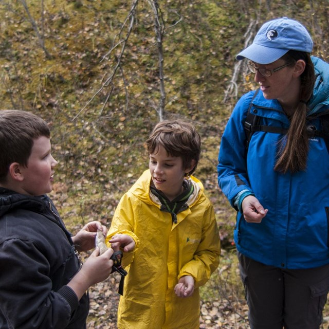 an alaska geographic instructor talks to children