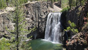 The San Joaquin rivers flows over a cliff, forming Rainbow Falls.
