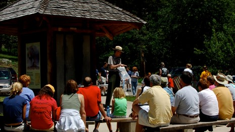 A park ranger presenting to a group of visitors