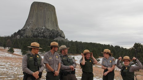 A group of park rangers pose for a comical photo.