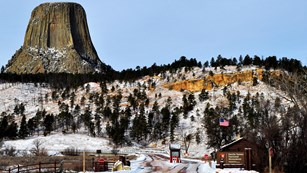 The Devils Tower Entrance Station with Devils Tower in the background.
