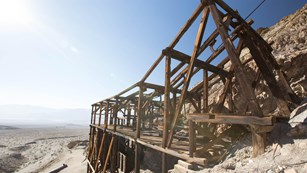 An old wooden mining structure in a desert landscape.