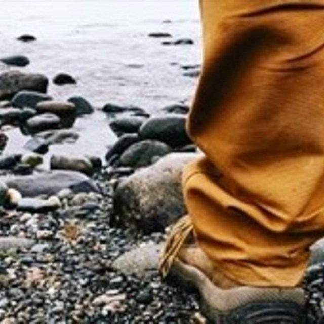 Ground view of someone standing on rocky beach.
