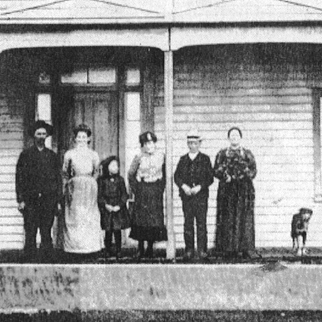 Historic photo of a family standing on the porch of the Ferry House