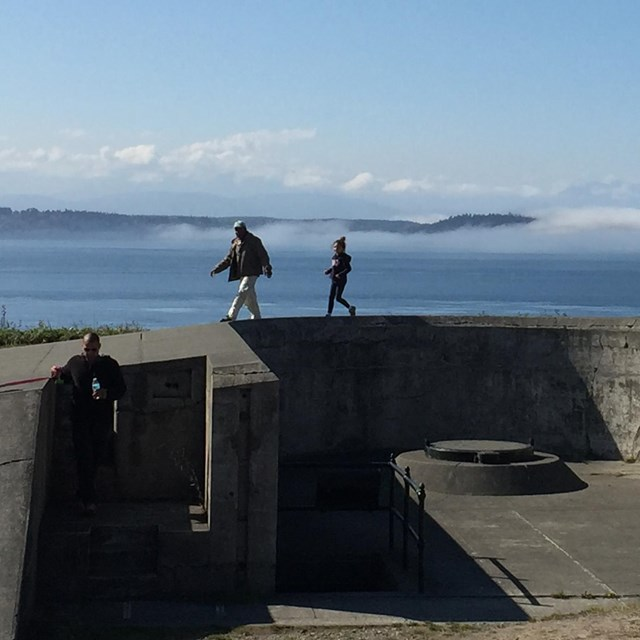 a family explores the military battlements at Fort Casey