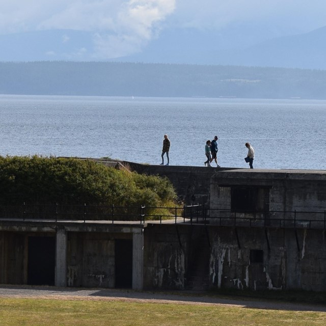 people explore the battlements at fort casey