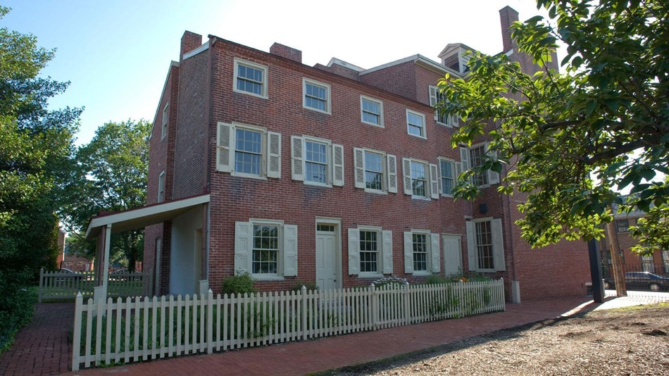 Exterior photo of the Edgar Allan Poe National Historic Site, a three-story brick building.