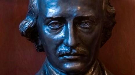 Color image of a detail of a bronze bust of Edgar Allan Poe.