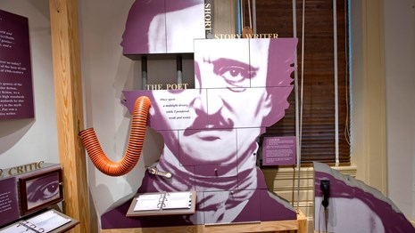 Color photo of an exhibit panel featuring a larger than life image of Edgar Allan Poe.