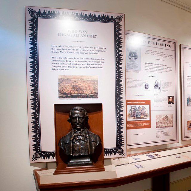 Color photo of an exhibit room with multiple exhibit panels and an image of Edgar Allan Poe.