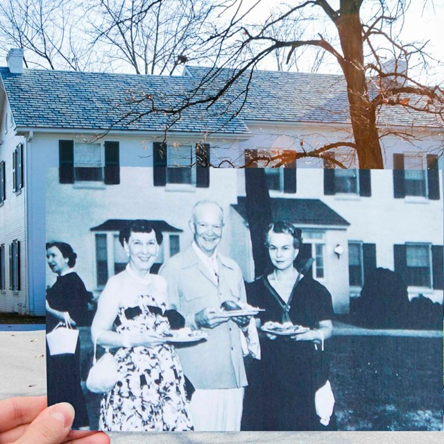 Old Photo of Ike and Mamie being held up by a volunteer inline with the Eisenhower house now.