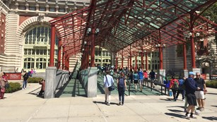 A long ramp leading to the entrance of Ellis Island's Main Building.
