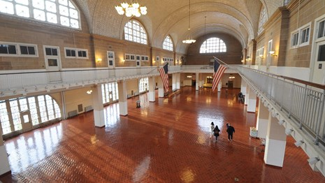A view of the Registry Room on Ellis Island from the balcony.
