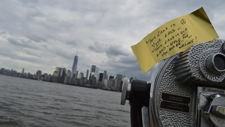 Paper gold brick on telescope with message from visitor looking at New York Harbor.