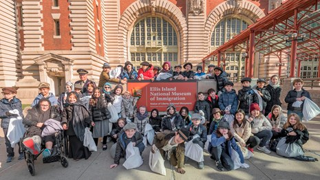 A class of school kids dressed as if they were immigrating through Ellis Island 100 years ago