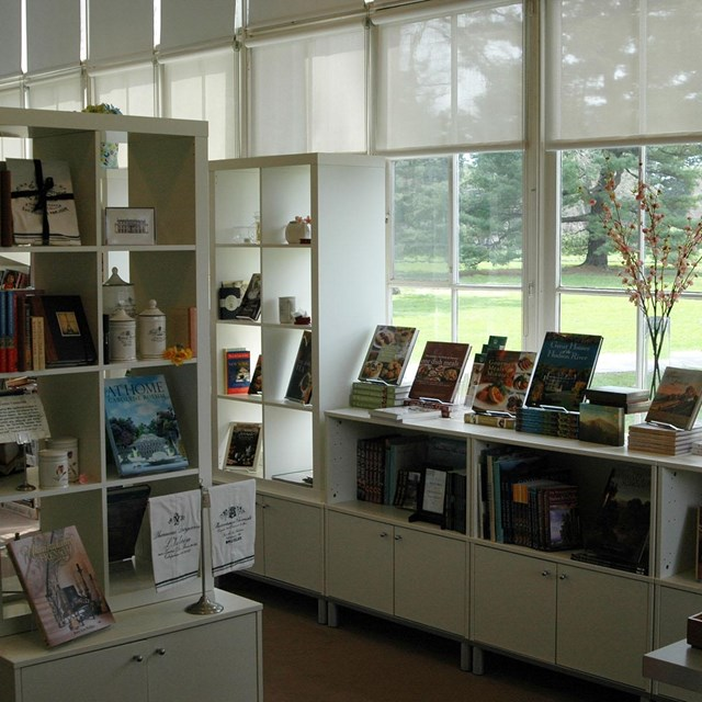 A brightly lit room with shelves of books and merchandise.