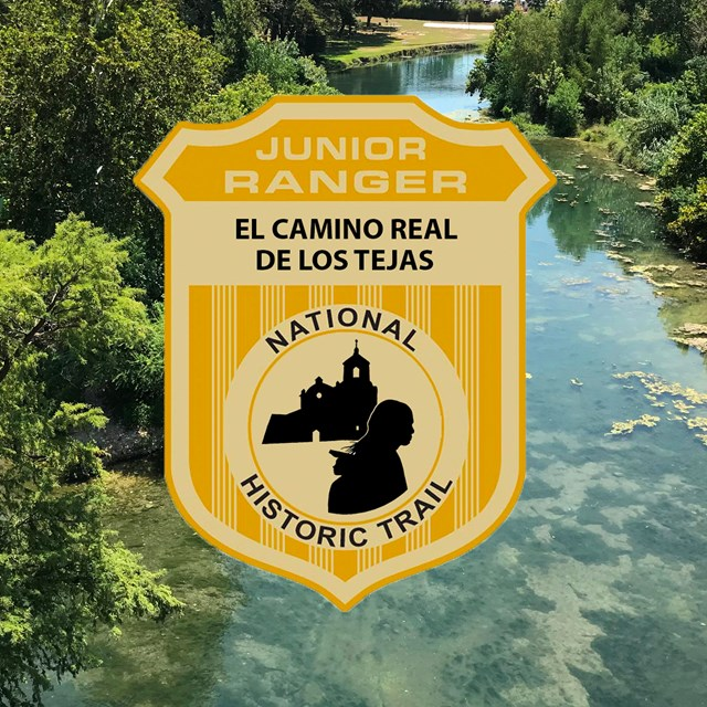 A junior ranger badge on top of an image of a creek in a vegetated area.