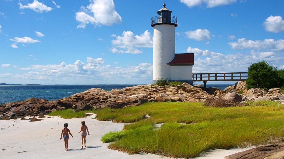 Children stroll by the Annisquam Lighthouse of Essex NHA