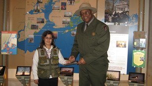 A Junior Ranger receives her badge.