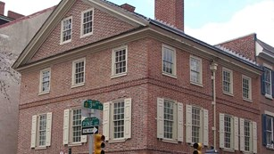 Corner view of large, red brick, colonial building