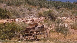 Wagon at the base of a desert hill