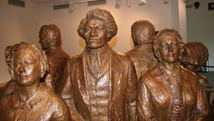 Statues of women's rights activists, including Frederick Douglass