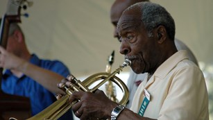 Jazz musician Joe Wilder sits in with the Howard Burns' Ensemble at the Niagara Centennial.