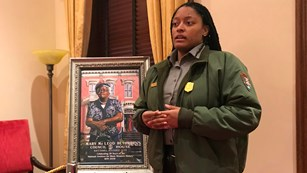 Ranger talking next to a painting of Mary McLeod Bethune