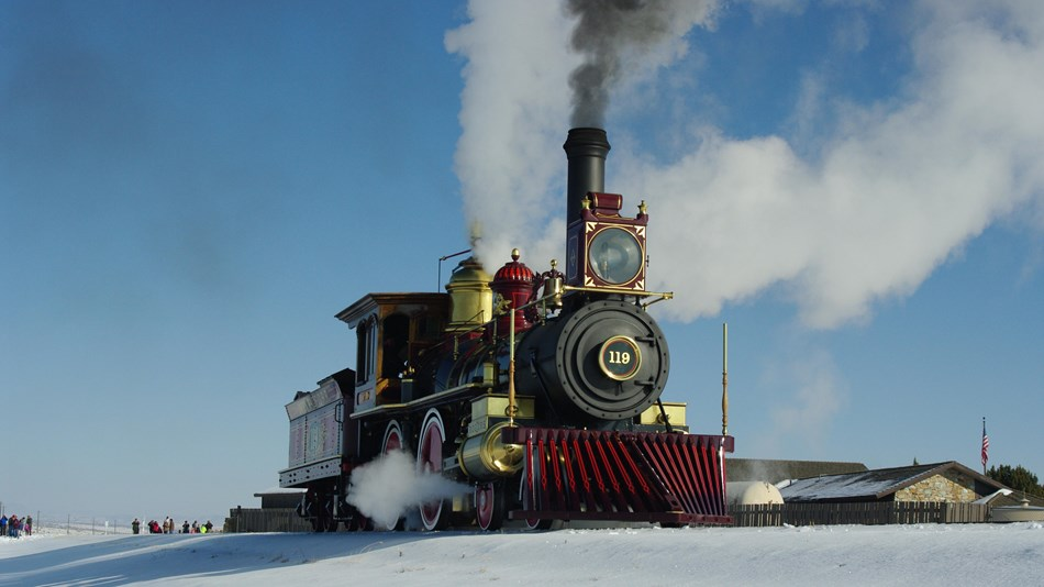 Steam engine train on a railroad track