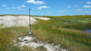 Acoustic monitoring station in a grass prairie