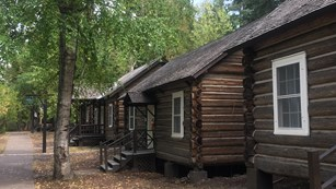 Row of log cabins.