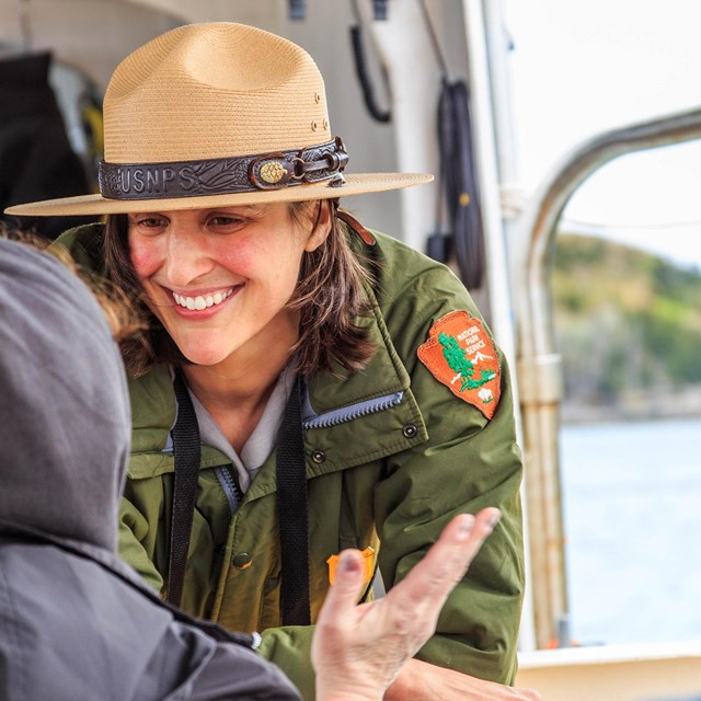 Woman park ranger smiling and sharing information
