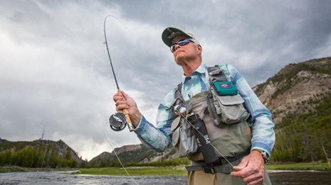 a man with a fly fishing pole