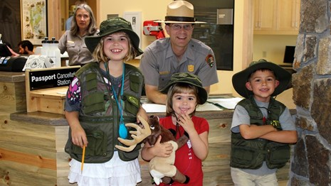 Junior Rangers at the desk in the Visitor Center