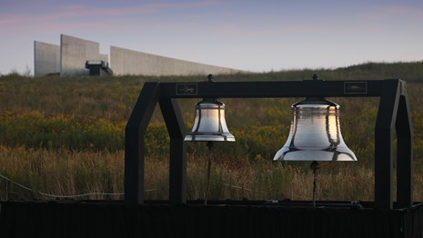 Two large bells known as the Bells of Remembrance sit in the field below the visitor center.