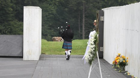 Bag piper walks out to the crash site.