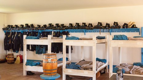 Army bunk beds in historically restored barracks building.