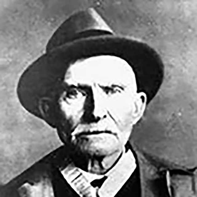 Historic black & white photo of Corp. Leander Herron as an old man.