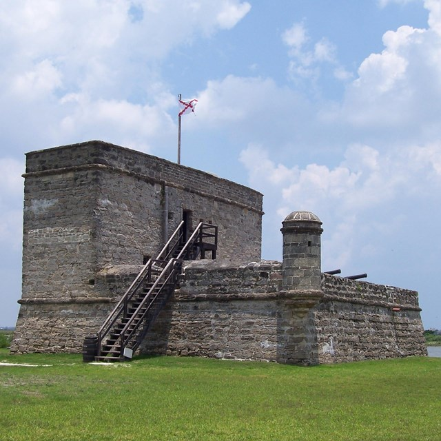 Fort Matanzas National Monument is centered with cloudy sky in the background