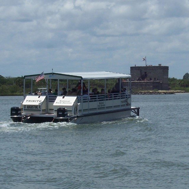 Profile of Fort Matanzas National Monument. Water in front and fort with cloudy sky in background.