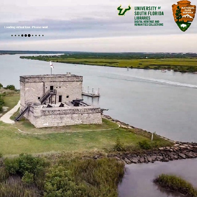 The fort from a drone with river around it and USF/NPS in text upon the image.