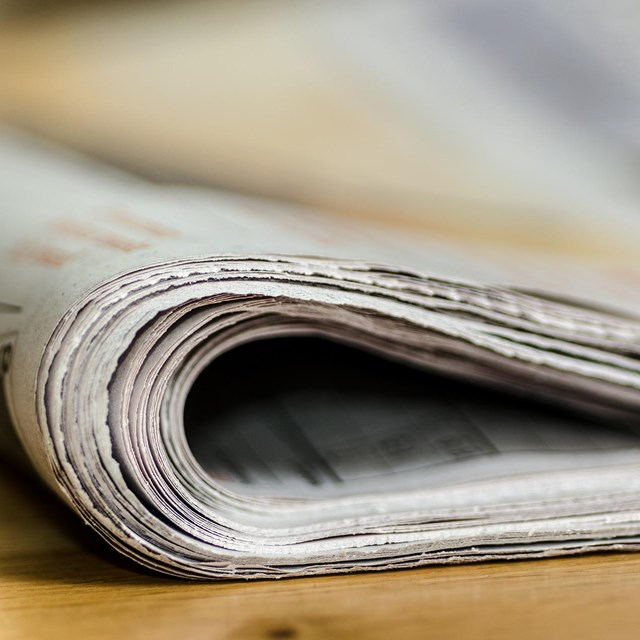 An image of a roll of newspaper.