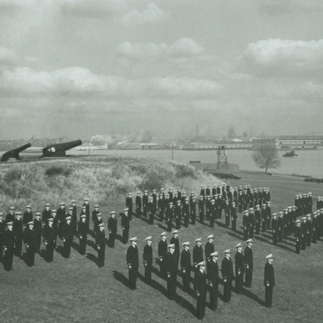 Coast Guard standing in formation at Fort McHenry's outer battery.