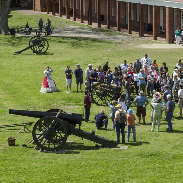 view from above of people watching cannon firing demonstration
