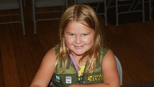 Girl with Junior Ranger Vest
