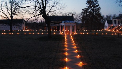 Looking at hundreds of candle lanterns on the parade grounds at dusk.