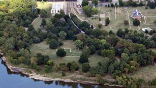 Aerial photo of Arkansas River, first fort foundation, commissary, visitor center, and gallows.
