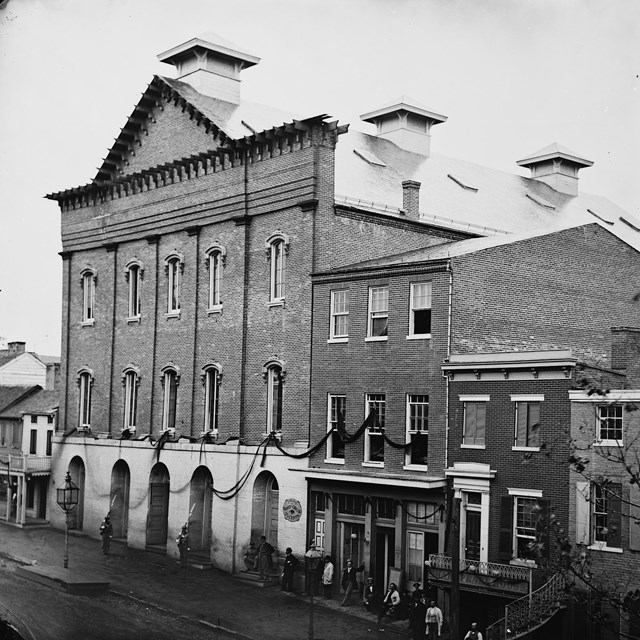 1865 photo of Ford's Theatre draped with mourning crepe
