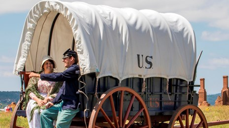 Living History Personnel around historic wagon