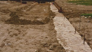 Looking west, the reconstructed foundations for the north palisade wall.